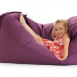 little girl posing on beanbag